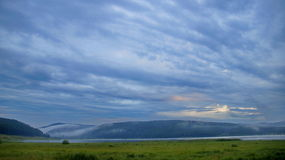 Morning sky in the clouds. Morning sky in clouds over the lake in the Republic of Bashkortostan Stock Image