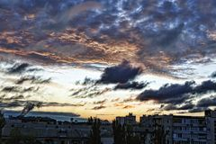 Morning sky in the clouds over a modern city. Dawn Stock Photo