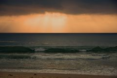 Morning cloudscape over breaking waves royalty free stock photo