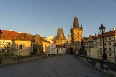 Morning sky with sunlight over the tower at Charles Bridge, Prague,Czech Republic royalty free stock photography