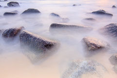 Morning smooth sea. On stone at phuket thailand stock images