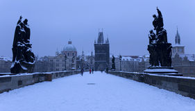Morning snowy Prague Old Town with Bridge Tower and St. Francis of Assisi Cathedral from Charles Bridge with its baroque Statues Royalty Free Stock Photos