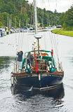 Morning song sailing along the Caledonian Canal. stock photos