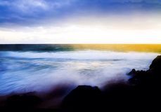 Morning Splash. Cool morning on the Pacific Ocean as the tide crashes the shore Stock Photography
