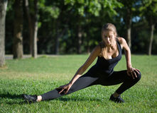 Morning sports exercises in park Royalty Free Stock Image