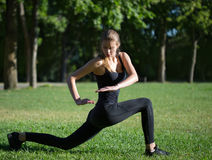 Morning sports exercises in park Stock Photos