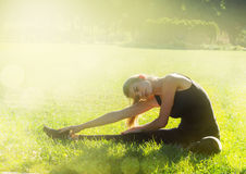 Morning sports exercises in park Stock Photography