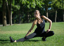 Morning sports exercises in park Royalty Free Stock Photo