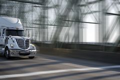 Morning star big rig semi truck with chrome grille moving on the. Morning star silver big rig semi truck with shiny chrome grille moving with semi trailer on stock photos