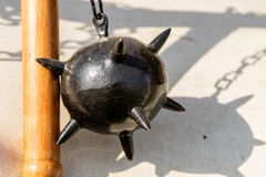 Morning Star, a medieval weapon made of a heavy iron ball with spikes, which is attached to a wooden stick by a chain. Strong royalty free stock photos