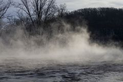 Morning steam above the river,winter scene from Wisconsin. Winter season in Wisconsin,steam above river royalty free stock image