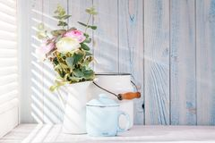 Morning still life. On shabby chic table and light from the blinds Royalty Free Stock Image