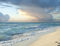 Morning storm clouds over beach on Caribbean Sea Royalty Free Stock Photos