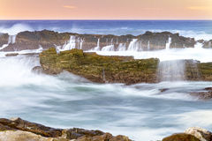 Morning at Storms River mouth. Sea water in motion over rocks at Storms River mouth in Eastern Cape, South Africa Stock Photography
