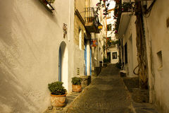 Morning, street of Cadaques, Costa Brava. Dawn. Narrow street in a small Mediterranean village. Cadaques, Costa Brava, Catalonia, Spain Stock Photo