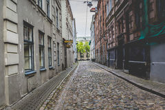 Morning street in medieval town of old Riga city, Latvia. Walkin Stock Image