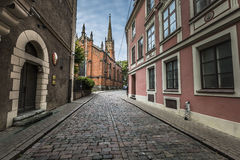 Morning street in medieval town of old Riga city, Latvia. Walkin Royalty Free Stock Images