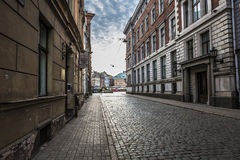 Morning street in medieval town of old Riga city, Latvia. Walkin Stock Images