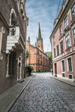 Morning street in medieval town of old Riga city, Latvia. Walkin Royalty Free Stock Photography