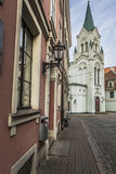 Morning street in medieval town of old Riga city, Latvia. Walkin Stock Photos