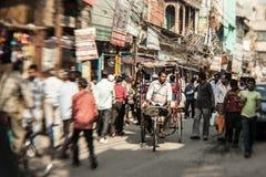 Morning on a street  in Old Delhi, India. DELHI, INDIA - NOVEMBER 10: Morning on a street at November 10, 2013 in Old Delhi, India. Indian capital still uses man Stock Image
