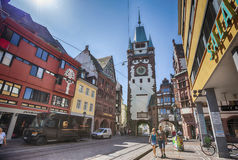 Morning street with view at The Martinstor, FREIBURG IM BREISGAU Stock Images