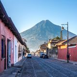 Morning in the streets of Antigua Guatemala with Aqua Volcano. View at the morning streets of Antigua Guatemala with Aqua Volcano royalty free stock photos