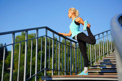 Morning stretch on the steps Stock Images