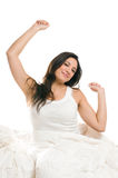 Morning stretching. Young woman stretching herself in the morning isolated on white background Royalty Free Stock Image
