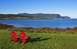 Morning sublimity, Newfoundland. Morning view of Rocky Harbour with signature Newfoundland red chairs, Newfoundland and Labrador, Canada Stock Photography