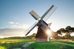 Morning summer sunshine behind Dutch windmill Stock Photography