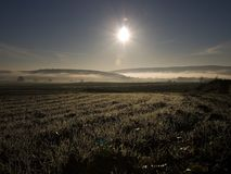 Morning sun. Above misty valley stock images
