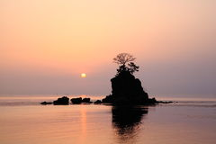 Morning sun at the Amaharashi coast Stock Image