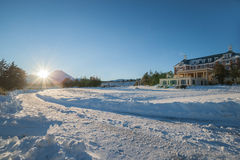 Morning sun bursts across mountain lodge. Stock Image