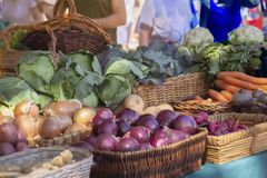 Morning sun cascades upon the display of produce at the Farmers Market royalty free stock image