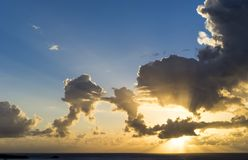 Morning sun with clouds and god rays. And blue sky royalty free stock photos