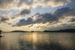 Morning Sun and Clouds in the North Woods Royalty Free Stock Photo