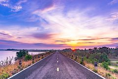 Morning sun, dam road. Road along dam with wonderful sky in the morning/this dam is earth dam royalty free stock image