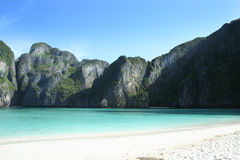 Morning sun on an empty beach. Secluded bay off the coast of Thailand Royalty Free Stock Images
