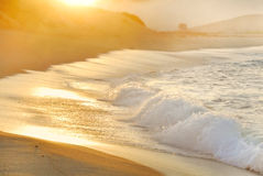 Morning sun and fog over ocean surf Royalty Free Stock Photography