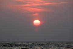 Morning sun. Hangs over the sea stock image