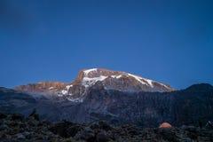 Morning sun illuminates Kibo, Mount Kilimanjaro, Tanzania Royalty Free Stock Photos
