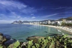 Morning sun on Ipanema Beach with city panorama in Rio de Janeiro Stock Photography