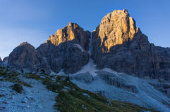 The morning sun in the mountains. Alps and sunny day. Via ferrata, sunny morning in the mountains. Dolomites, green valley Stock Photos