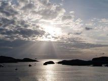 Morning sun ray over the sea. Morning sun ray over calm sea in the island Stock Image