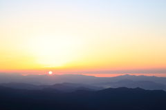 Morning sun rises in the mountain Stock Images