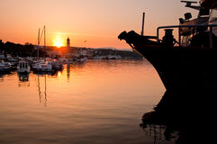 Morning sun rising at Krk port with ship close - Croatia Royalty Free Stock Images