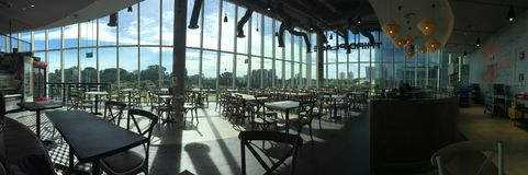 Sunshine through cafeteria windows 02. Morning sun shine through the glass windows, empty hawker centre cafeteria in the morning royalty free stock photography