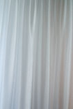 Morning sun shines through the curtains. Royalty Free Stock Images