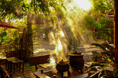 Morning sun. Shines through the smoke of an ancient outdoor kitchen Royalty Free Stock Image